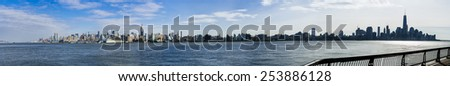 Jersey city - NJ circa dec 2014: Manhattan skyline view from harborside hudson river in jersey city at morning time. - stock photo