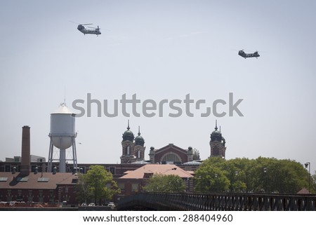 JERSEY CITY, NJ - MAY 26 2015: US Marine Corps helicopters fly above Ellis Island on the Upper New York Bay before the USS San Antonio departs Pier 92 at the end of Fleet Week NY 2015. - stock photo