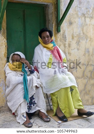 JERUSALEM - APRIL 14 : Ethiopian Orthodox worshipers await the start of the Holy fire ceremony at the Ethiopian section of the Holy Sepulcher in Jerusalm Israel on April 14 2012