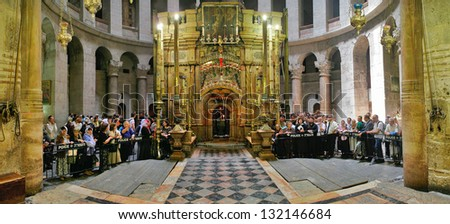 JERUSALEM - APRIL 23: Panorama of Church of the Holy Sepulchre and pilgrims around chapel The Edicule with tomb of Jesus Christ during Easter celebrations in Jerusalem, Israel on April 23, 2006. - stock photo