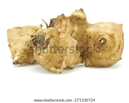 Jerusalem artichoke or topinambur on a white background  - stock photo