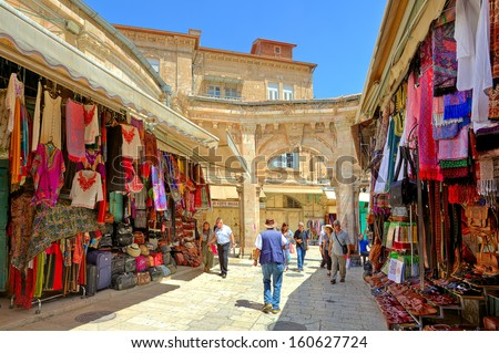 JERUSALEM - AUGUST 21: Bazaar in Old City offers middle east traditional products and souvenirs. It is very popular site with tourists and pilgrims visiting Jerusalem, Israel on August 21, 2013. - stock photo