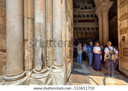 JERUSALEM- AUGUST 21: Columns at the entrance to Church of the Holy Sepulchre - main pilgrimage destination contains Golgotha and the Tomb of Jesus Christ in Jerusalem, Israel on August 21, 2013. - stock photo