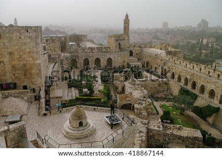 Jerusalem citadel and Tower of David with cityscape in sandstorm at background. Israel - stock photo