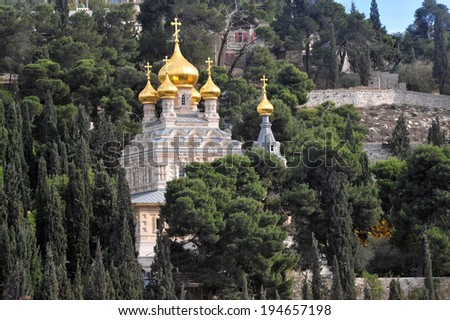 JERUSALEM  - DEC 12 2008: St. Mary Magdalene Church in Mount of Olives in Jerusalem, Israel.It's Russian Orthodox church located on the Mount of Olives, near the Garden of Gethsemane in East Jerusalem - stock photo