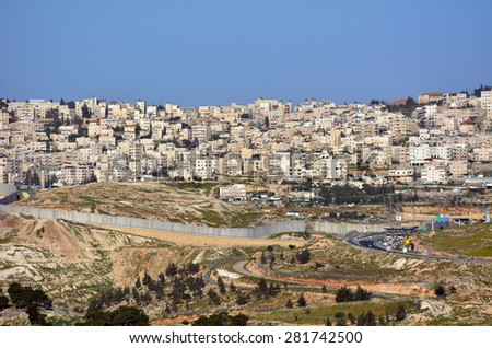 JERUSALEM, ISR - MAR 19 2015:The Israeli West Bank barrier in East Jerusalem.It protects Israel civilians from Palestinian political violence such as terror suicide bombing attacks. - stock photo