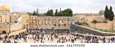 JERUSALEM, ISRAEL - APRIL 04: View on the Wailing Wall, orthodox religious Jews and tourists during the Jewish Pesach (Passover) celebration on April  04, 2015 in Jerusalem, Israel - stock photo