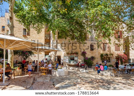 JERUSALEM, ISRAEL - AUGUST 21, 2013: Little square with gift shops and outdoor restaurants in the shade of trees in Jewish Quarter - popular place with locals and tourists visiting Jerusalem, Israel. - stock photo