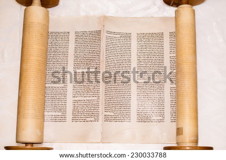 JERUSALEM, ISRAEL, CIRCA 2014: The Hebrew handwritten Torah, on a synagogue alter, illustrating Jewish holidays, during fests. Top view - stock photo