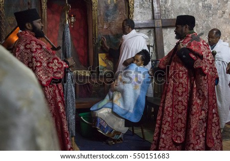 Jerusalem, Israel - December 12, 2010: Ethiopian monks hold christening mass in Ethiopian Chapel in the Church of Holy Sepulchre in Jerusalem. Ethiopian chapel is located outside main church building