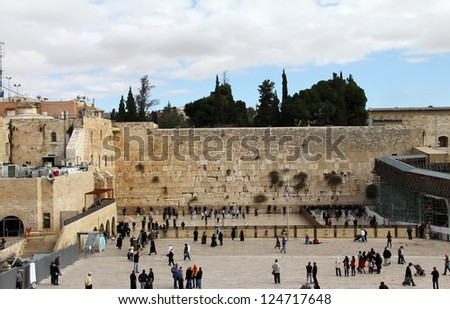 JERUSALEM, ISRAEL - DECEMBER 19: Jewish worshipers pray at the Wailing Wall an important jewish religious site  on December 19, 2012  in Jerusalem, Israel - stock photo