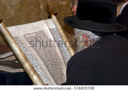 JERUSALEM, ISRAEL - DECEMBER 6: Orthodox Jewish man prays at the Western Wall on December 6, 2013, Jerusalem, Israel. The Wall is the holiest place for Jewish people. All of them go there to pray.  - stock photo