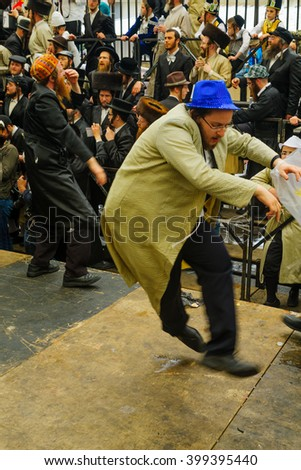 JERUSALEM, ISRAEL - FEBRUARY 25, 2016: Jewish men attend and dance, as part of a celebration of the Jewish Holyday Purim, in the ultra-orthodox neighborhood Mea Shearim, Jerusalem, Israel - stock photo