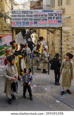 JERUSALEM, ISRAEL - FEBRUARY 25, 2016: Street scene of the Jewish Holyday Purim, with locals, some wearing costumes, in the ultra-orthodox neighborhood Mea Shearim, Jerusalem, Israel - stock photo
