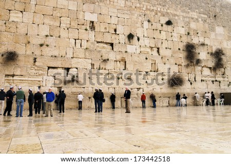 JERUSALEM, ISRAEL - FEBRUARY 25, 2010: Unidentified people praying in front of the Wailing Wall. - stock photo