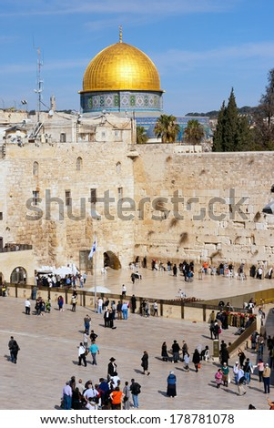 JERUSALEM, ISRAEL - JAN 23: Jewish worshippers at the Wailing Wall on Jan 23, 2011 Jerusalem, Israel. The wall is the most sacred site in Judaism outside of the Temple Mount itself.