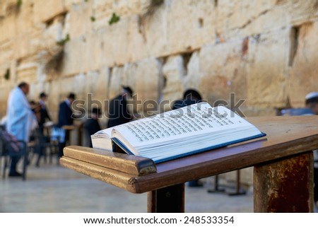 Jerusalem, Israel - January 30, 2015: Western Wall also known as Wailing Wall or Kotel. The Torah Book in the foreground. - stock photo