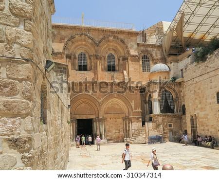 JERUSALEM, ISRAEL - JULI 13, 2015: People at the entrance to the Church of the Holy Sepulchre. Juli 13, 2015. Jerusalem, Israel. - stock photo