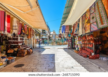 JERUSALEM, ISRAEL - JULY 10, 2014: Bazaar in Old City of Jerusalem offers middle east traditional products and souvenirs. It is very popular with locals, tourists and pilgrims visiting Israel. - stock photo