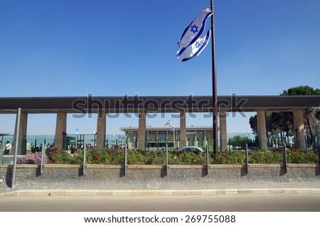 JERUSALEM, ISRAEL - JULY 06, 2014: Entrance to the Knesset, decorated with the national flag, Jerusalem - stock photo