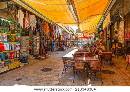 JERUSALEM, ISRAEL - JULY 10, 2014: Market in Muristan - complex of streets, shops and restaurants in Christian quarter of Old City. It is very popular with tourists and pilgrims visiting Holy Land. - stock photo