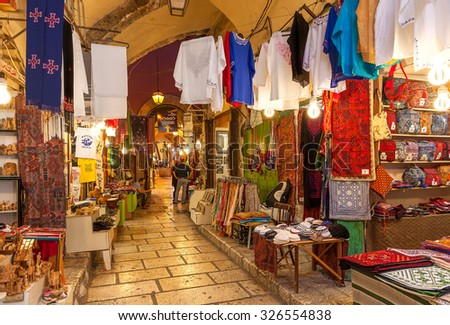 JERUSALEM, ISRAEL - JULY 16, 2015: Market in Old City of Jerusalem offers middle east traditional products and souvenirs. It is very popular with locals, tourists and pilgrims visiting Israel. - stock photo