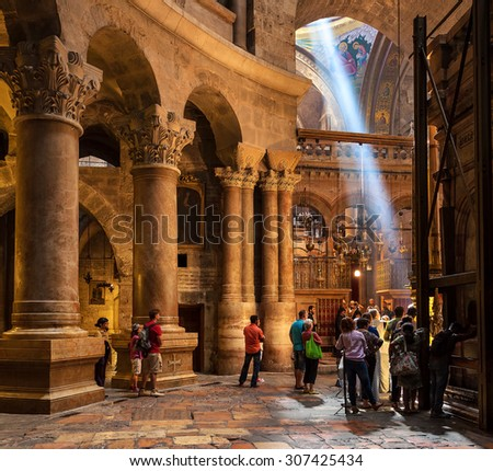 JERUSALEM, ISRAEL - JULY 26, 2015: People inside Church of the Holy Sepulchre - place where according christian tradition Jesus Christ was crucified, buried and resurrected. - stock photo