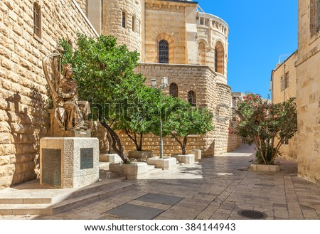 JERUSALEM, ISRAEL - JULY 16, 2015: Sculpture of King David playing harp near entrance to his tomb on Mount Zion. This is also the place believed by Christians of the Last Supper of Jesus.
