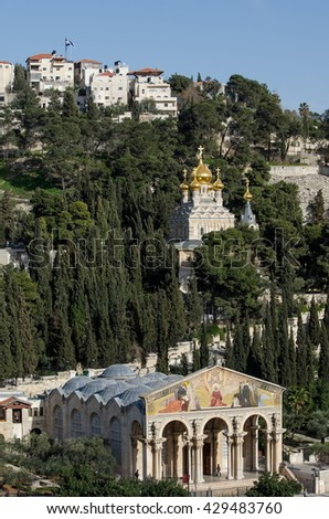 JERUSALEM , ISRAEL - JULY  3, 2013: The Church of All Nations, (Church or Basilica of the Agony) and Church of Mary Magdalene in one shot. Jerusalem. Israel - stock photo