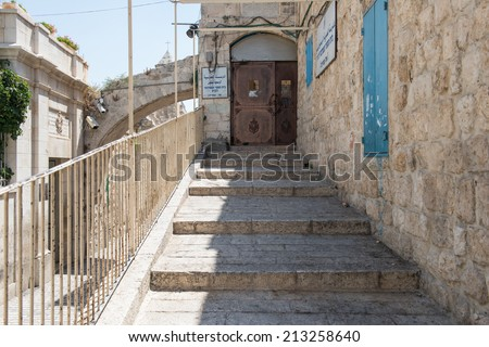 JERUSALEM,ISRAEL - JULY 25: Via Dolorosa on July 25,2014 in Jerusalem.The way in Old City of Jerusalem, held to be the path that Jesus walked, carrying his cross, on the way to his crucifixion.