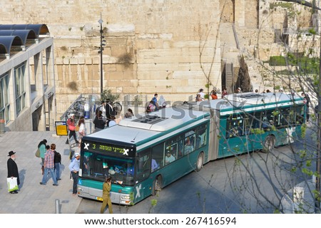 JERUSALEM, ISRAEL - MARCH 20, 2014: People on the bus stop The Western Wall in the Old City. The Old City is listed as UNESCO World Heritage site since 1981. - stock photo