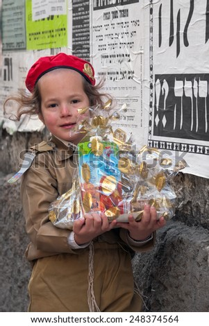JERUSALEM, ISRAEL - MARCH 15, 2006: Purim carnival in the famous ultra-orthodox quarter of Jerusalem - Mea Shearim. Portrait of a boy children dressed in carnival costumes soldier.