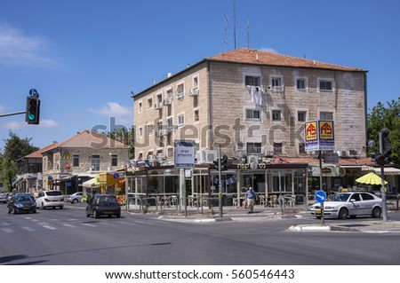 JERUSALEM, ISRAEL - MAY 05, 2015: Houses, shops and traffic in the residential district of the German colony