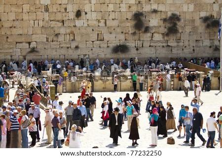 JERUSALEM, ISRAEL - May 13: Hundreds of Jewish worshipers pray at the Wailing Wall on May 13, 2011 in Jerusalem, Israel. - stock photo