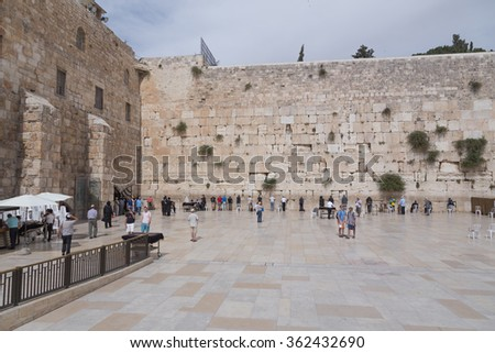 JERUSALEM , ISRAEL - MAY 17 , 2014 :  The Wailing Wall .  Wailing Wall is the most famous jewish religious monument in Jerusalem.