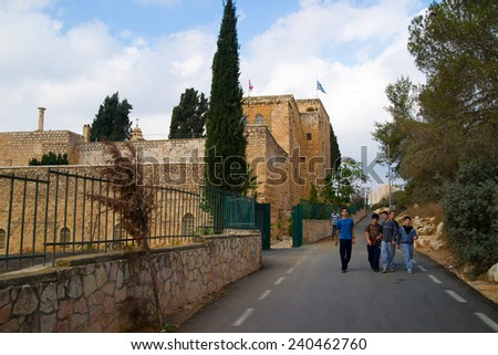 JERUSALEM, ISRAEL - NOVEMBER 03, 2011: Several teenagers walking on street in Cross Valley in Jerusalem, Israel. On the valleys west side is the hill of Givat Ram and the Israel Museum   - stock photo