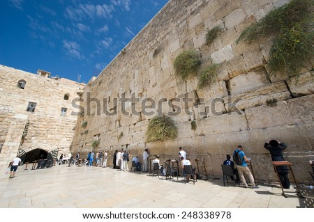 JERUSALEM, ISRAEL - OCT 07, 2014: Jewish men are praying in front of the western wall in the old city of Jerusalem - stock photo