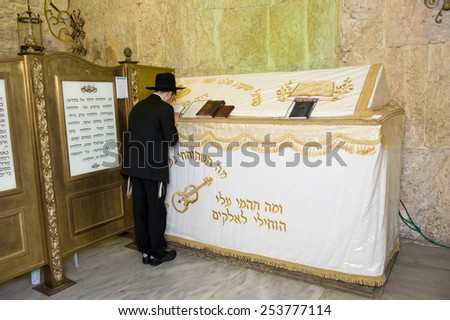 JERUSALEM, ISRAEL - 08 OCTOBER, 2014: An orthodox jewish man is praying at The tomb of King David on Mount Zion in Jerusalem - stock photo