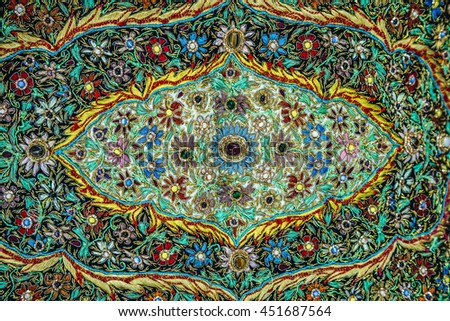 Jerusalem, Israel - October 22, 2015. Close up on ornated rug for sale on Arab baazar located inside the walls of the Old City of Jerusalem - stock photo