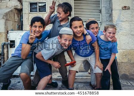 Jerusalem, Israel - October 22, 2015. Jewish boys pose  for photo in Jerusalem city - stock photo