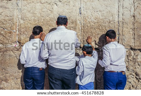 Jerusalem, Israel - October 22, 2015. Jews prays in front of ancient limestone wall known as Wailing Wall in the Old City of Jerusalem - stock photo