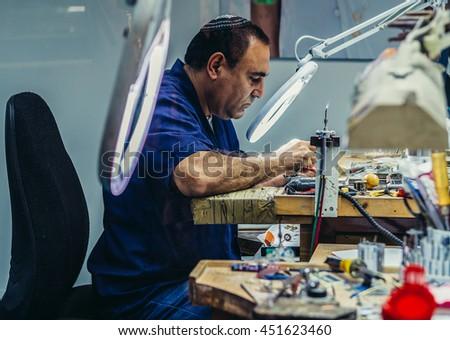 Jerusalem, Israel - October 18, 2015. Man works in Yvel Jewelry Factory in Jerusalem - stock photo
