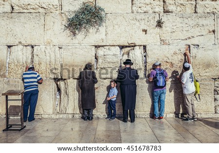 Jerusalem, Israel - October 22, 2015. People prays in front of ancient limestone wall known as Wailing Wall in the Old City of Jerusalem