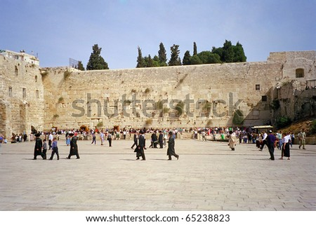 JERUSALEM, ISRAEL - OCTOBER 17: Rabbis go to pray to the Western Wall at October 17, 1997 in Jerusalem, Israel. The Western Wall is the holiest place for the Jewish people in the whole world.