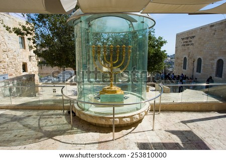 JERUSALEM, ISRAEL - 08 OCTOBER, 2014: The golden menorah outside of 'the Temple Institute' wiil be used in the future for the third temple. The menorah is made of one talent of 24 karat pure gold - stock photo