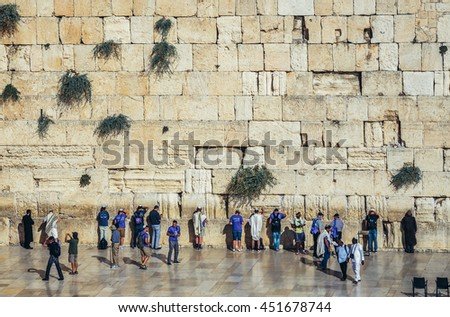 Jerusalem, Israel - October 22, 2015. Tourists and pilgrims in front of Wailing Wall on the Old Town of Jerusalem