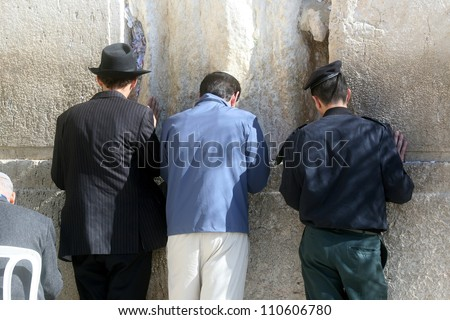 JERUSALEM - JANUARY 02: Jewish men pray at the western wall January 02, 2008 in Jerusalem, Israel. The wall is one of the holiest sites in Judaism attracting thousands of worshipers daily.