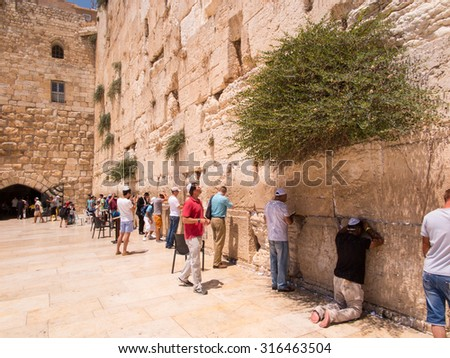 JERUSALEM - Juli 15: Jewish prayers and pilgrims beside Western Wall Juli 15, 2015 in Jerusalem, Israel. - stock photo