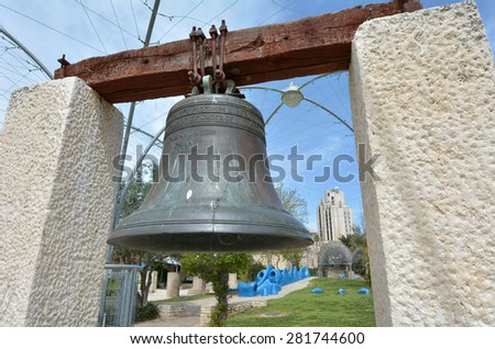 JERUSALEM - MAR 25 2015:Replica of the American Liberty Bell in the center of Gan Hapaamon park. The Liberty Bell is an iconic symbol of American independence, located in Philadelphia, Pennsylvania. - stock photo