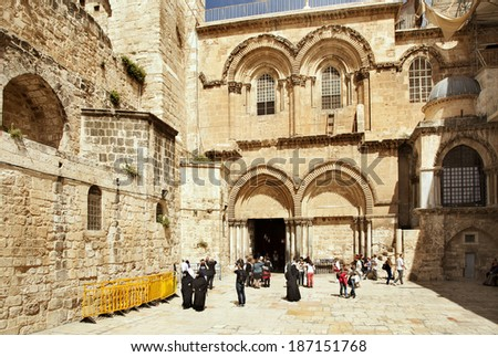 JERUSALEM - MARCH 23: Enter in the Church of the Holy Sepulchre where Jesus was buried, Jerusalem on March 23, 2014.  - stock photo